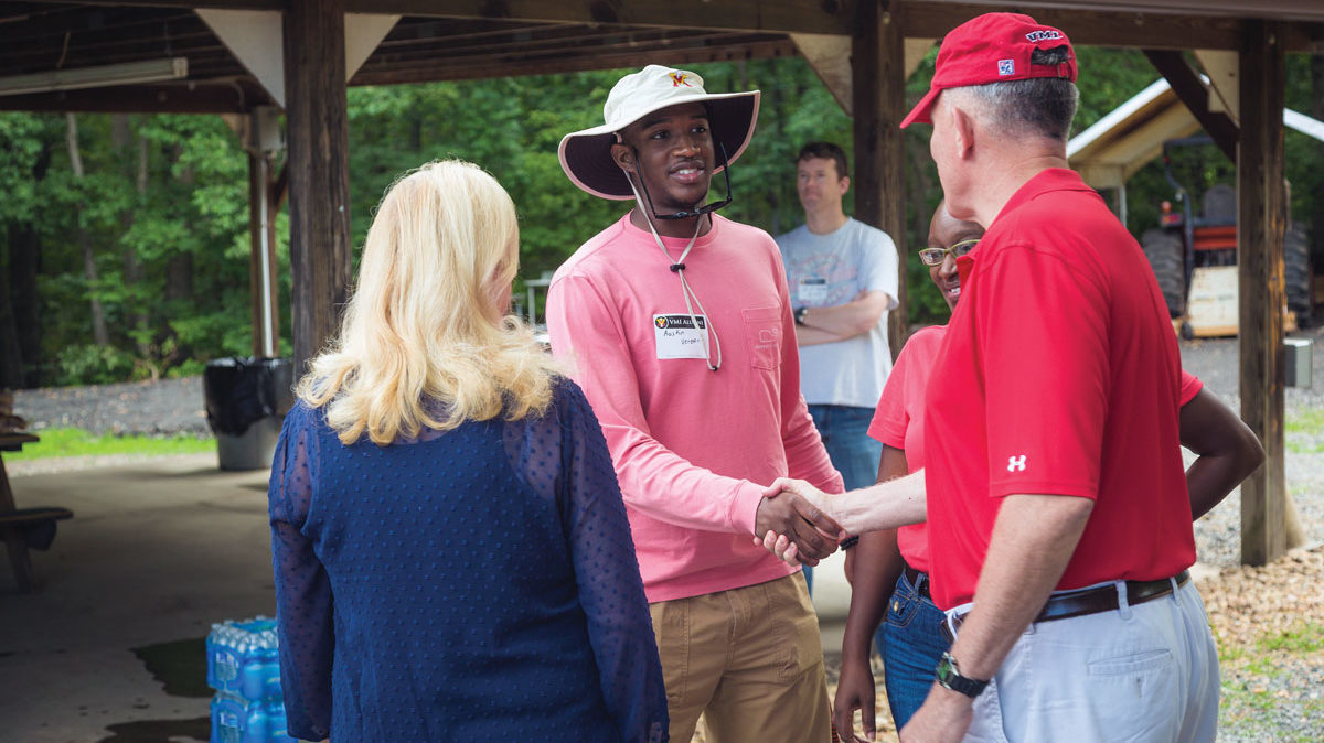 VMI alumni shaking hands at picnic