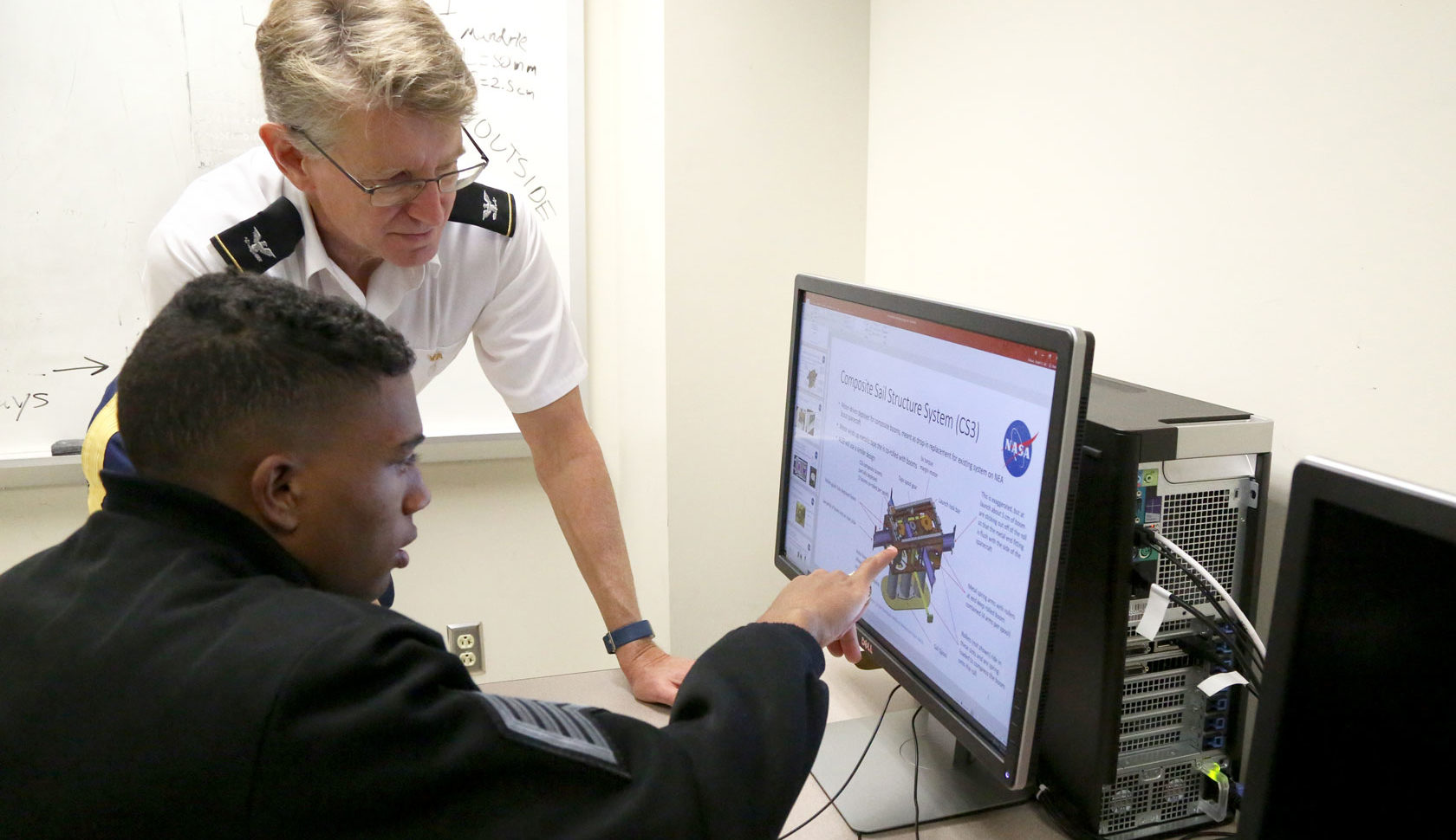 VMI Professor and student looking at computer screen