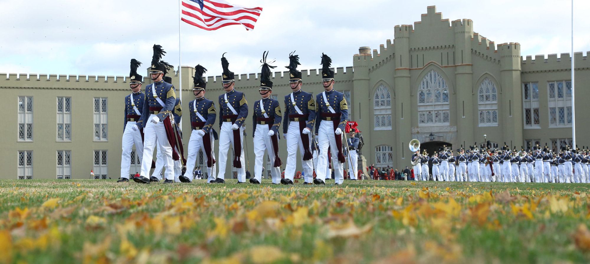 VMI soldiers marching with American flag