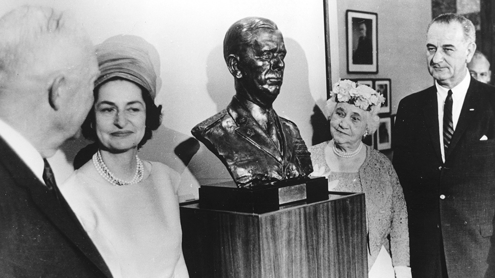 President Eisenhower with bust of George C. Marshall